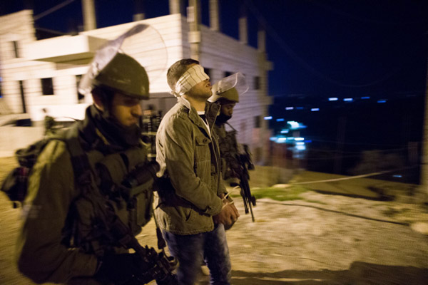 Illustrative photo of Israeli soldiers arresting a Palestinian man in the Dheisheh Refugee Camp near the West Bank city of Bethlehem. (Nati Shohat/Flash90)