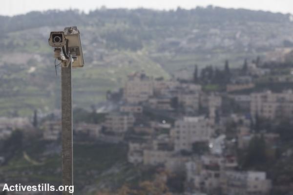 Israeli surveillance cameras in a Palestinian neighborhood of East Jerusalem. (Oren Ziv/Activestills.org)