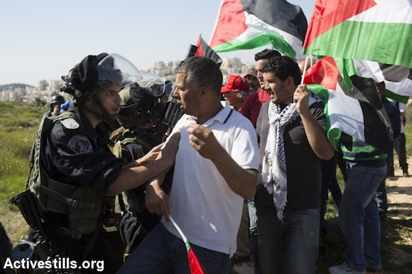 Illustrative photo of an Israeli Border Police officer confronting a Palestinian protester. (Oren Ziv/Activestills.org)