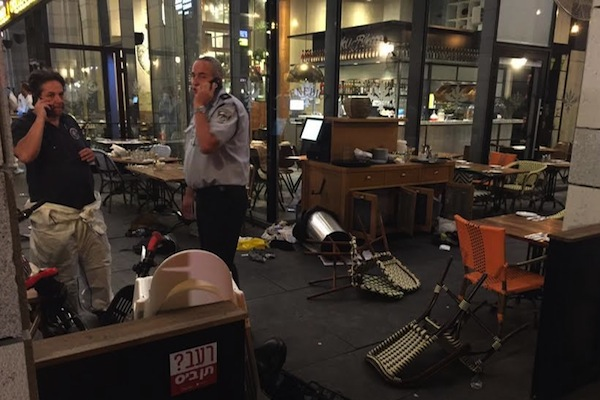 Israeli police seen at a restaurant in Sarona Market following the shooting attack that left four Israelis dead, central Tel Aviv, June 8, 2016. (photo: Israel Police Spokesperson)
