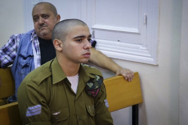 Elior Azaria, the Israeli soldier, who shot a Palestinian attacker in Hebron, is seen at a court hearing in Jaffa's military court, July 11, 2016. Azaria was filmed shooting the Palestinian in the head, after the latter posed no threat. (photo by Flash90)