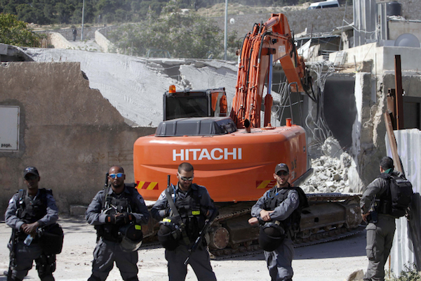 Israeli security forces demolish a Palestinian family's home in a-Tur, April 24, 2013. (Sliman Khader/Flash90)