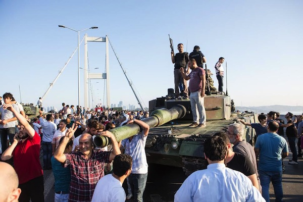 Supporters of the attempted military coup in Turkey seen standing atop a tank in Istanbul, July 16, 2016. (photo: Deepspace / Shutterstock.com)