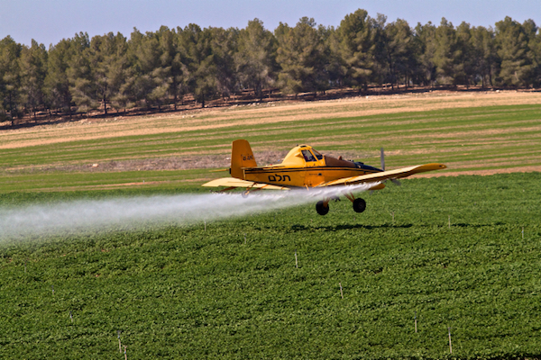 Illustrative photo of a crop-duster spraying agricultural lands with chemical agents. (Doron Horowitz/Flash90)