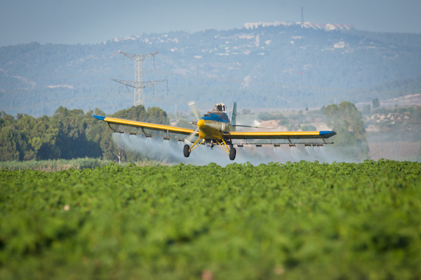 Illustrative photo of a crop-duster spraying agricultural lands with chemical agents. (Moshe Shai/FLASH90)