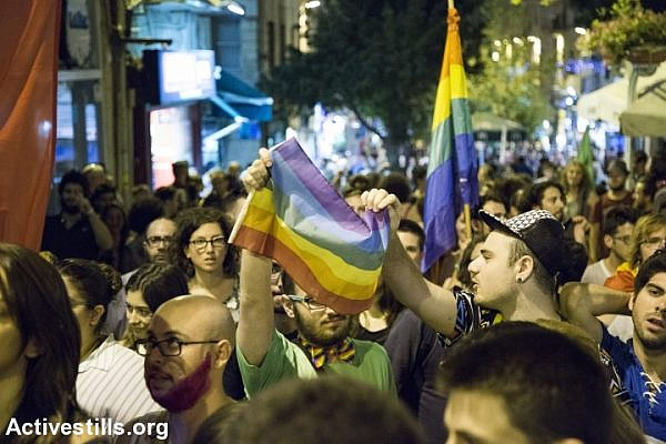 Hundreds of people march through Jerusalem several hours after a stabbing attack at the city's Pride Parade, July 30, 2015. One teenager was killed. (Keren Manor/Activestills.org)