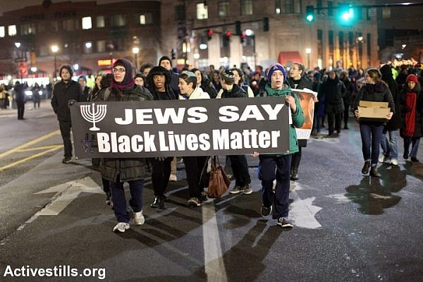 Jewish activists take part in a Black Lives Matter protest in Brookline, MA, December 16, 2014. (Tess Scheflan/Activestills.org)