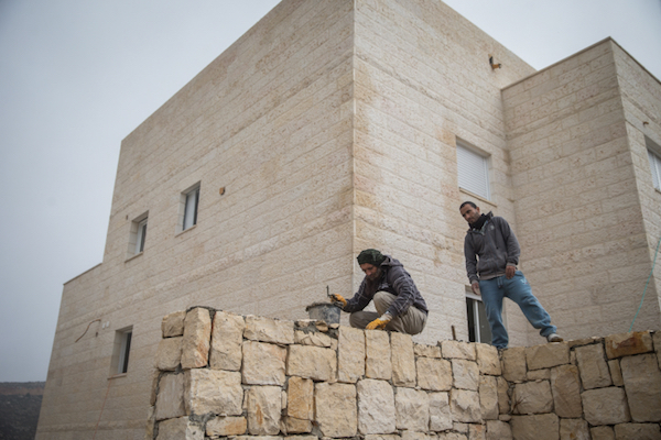 Palestinian construction workers in an Israeli settlement in the West Bank, November 10, 2015. (Nati Shohat/Flash90)