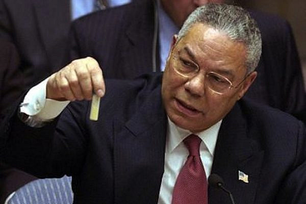 Colin Powell holding a model vial of anthrax while giving a presentation to the United Nations Security Council in February 2003.