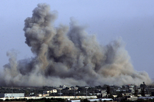 Smoke from an Israeli air strike in Rafah, southern Gaza Strip, July 12, 2014. (Abed Rahim Khatib/Flash90)