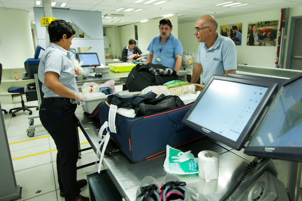 Arab passengers are profiled at Israeli airports and are often subject to strip searches, which Adalah says are illegal. (Moshe Shai/Flash90)