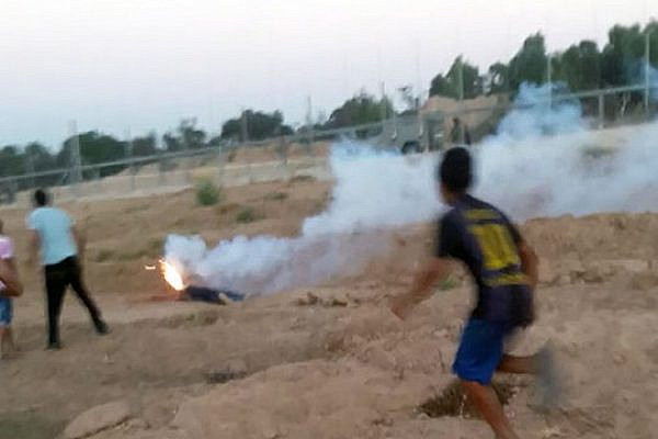 A military illumination flare burning the face of Abdel-Rahman al-Dabbagh, which killed him, Gaza Border, September 9, 2016. (Screenshot, DCI-Palestine)