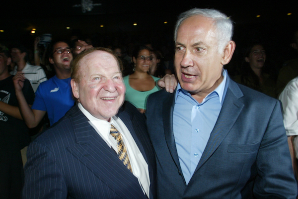 Casino billionaire Sheldon Adelson, the owner the pro-Bibi newspaper, Israel Hayom, is seen embracing Benjamin Netanyahu. (Olivier Fitoussi/Flash90)