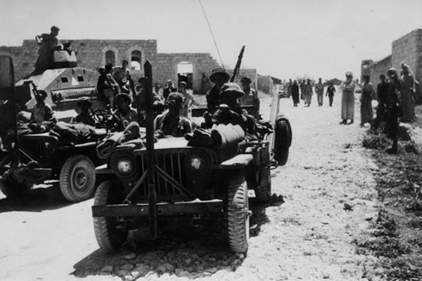 Israeli soldiers seen in Kafr Qasim in 1948. (GPO)