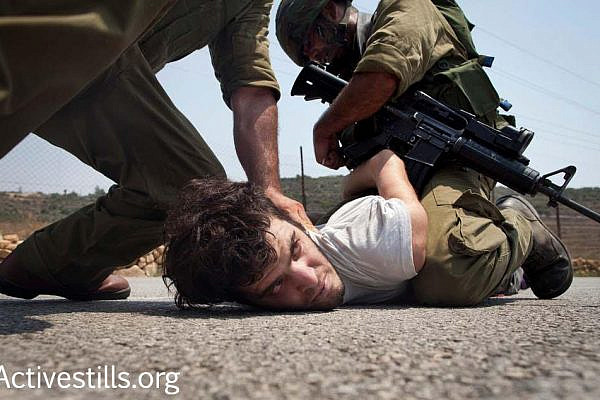 Israeli activist Renen Raz is seen arrested by Israeli soldiers during a demonstration in the West Bank village Nabi Saleh. Raz passed away in October 2016. (Activestills.org)