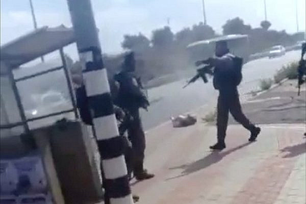 Screenshot of a video showing Israel Border Police officers shooting a 19-year-old Palestinian attacker after she is on the ground.