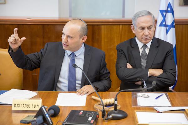 Israeli Prime Minister Benjamin Netanyahu crosses his arms as Education Minister Naftali Bennett speaks at a cabinet meeting, August 30, 2016. (Emil Salman/Pool)
