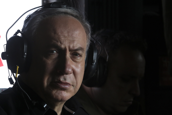 Israeli Prime Minister Benjamin Netanyahu in a helicopter as he tours the separation fence near the Palestinian town of Tarqumiyah, West Bank, July 20, 2016. (Marc Israel Sellem/Pool)