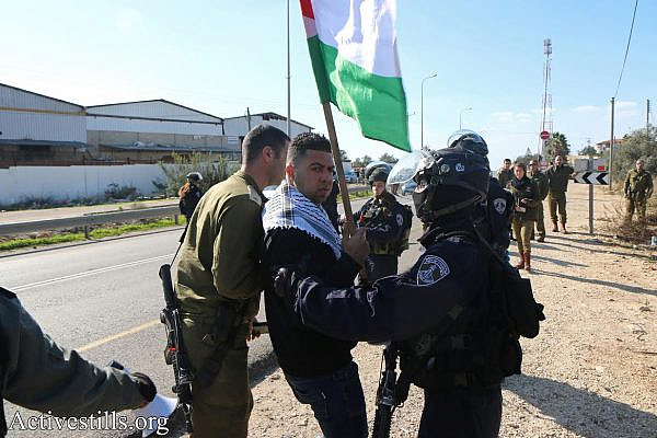Israeli security forces detain a Palestinian protester in Nabi Elias, where dozens of Palestinians and several Israelis protested against plans to expropriate agricultural land to build a settler-only bypass road. (Ahmad al-Bazz/Activestills.org)