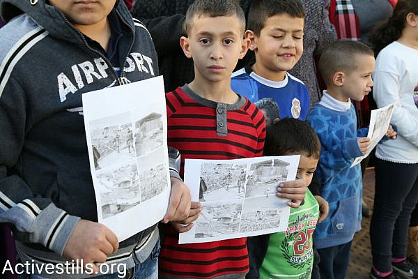 Arab youth demonstrate against the demolition of 11 homes by Israeli authorities in the Arab town of Qalansuwa, central Israel, January 11, 2017. (Keren Manor/Activestills.org)