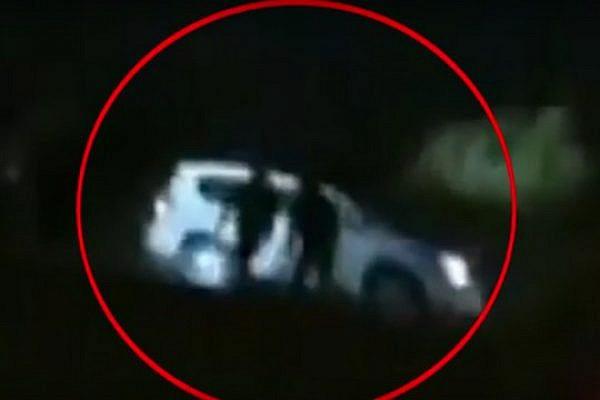 Screenshot of Al Jazeera footage showing that Yaqub Abu al-Qi'an was driving with his headlights on when police shot him.
