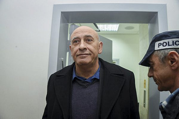 Joint List MK Basel Ghattas is brought to court for a remand on his arrest at the Rishon Lezion Magistrate's Court, December 27, 2016. (Yair Sagi/Flash90)