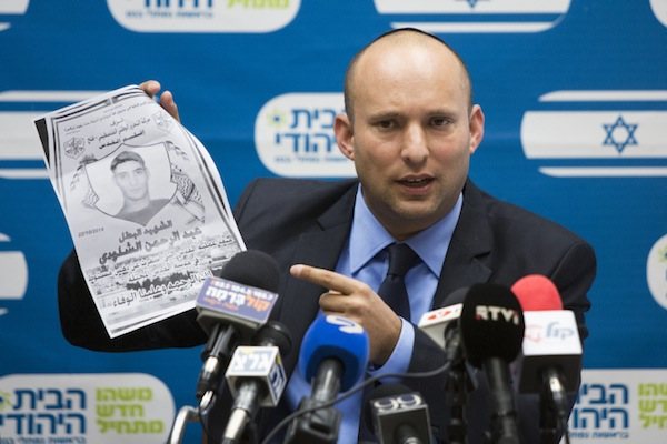 Naftali Bennett, leader of the Jewish Home party holds a picture of Adbel-Rahman Shaloudi, a Palestinian from East Jerusalem who drove his car into a train station and killed a woman and an infant, Ocotber 27, 2014. (Yonatan Sindel/Flash90)