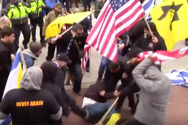 Members of the Jewish Defense League (JDL) beat a 55-year-old Palestinian man outside the AIPAC convention in Washington D.C., March 26, 2017. (Screenshot)