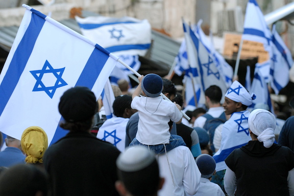 An Israeli child waves an Israeli flag in the Muslim Quarter of Jerusalem's Old city during a march celebrating Jerusalem Day, May 12, 2010. (Gili Yaari/Flash90)
