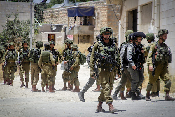Israeli soldiers patrol in the West Bank city of Hebron, June 1, 2016. (Wisam Hashlamoun/Flash90)