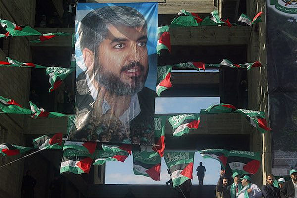 Poster image of Hamas leader Khaled Mashal during a rally marking the 21st anniversary of the Islamist movement's founding, Gaza City, Gaza,  December 14, 2008. (Abed Rahim Khatib / Flash90)