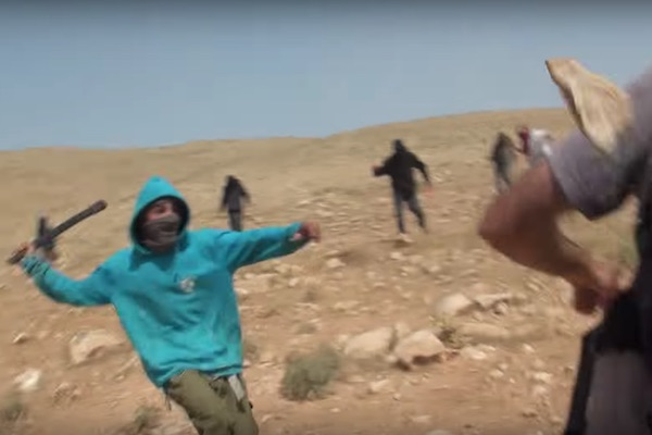 Jewish Israeli settlers attack activists with Ta'ayush in the Jordan Valley, April 21, 2017. (Ta'ayush/Screenshot)