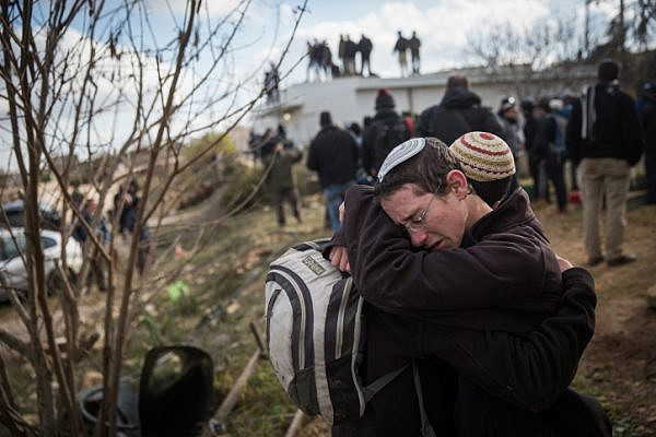 Young Jewish boys seen crying in the illegal outpost of Amona, February 1, 2017, during the settlement's evacuation. (Hadas Parush/Flash90)