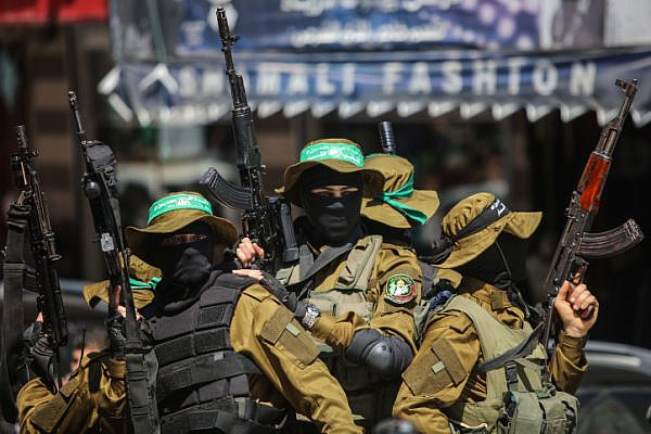 Masked gunmen from the Qassam brigade, the armed wing of Hamas, attend the funeral of Mazen Faqha in Gaza City, Saturday, March, 25, 2017. (Wissam Nassar/Flash90)