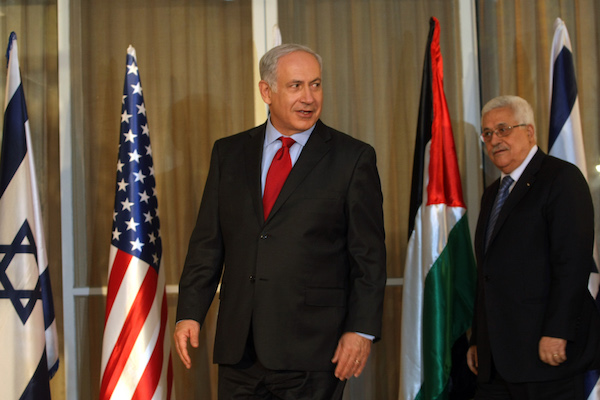 Israeli Prime Minister Benjamin Netanyahu (L) stands with Palestinian President Mahmoud Abbas, at his residence in Jerusalem, Israel, Wednesday, Sept. 15, 2010. (Kobi Gideon/Flash90)