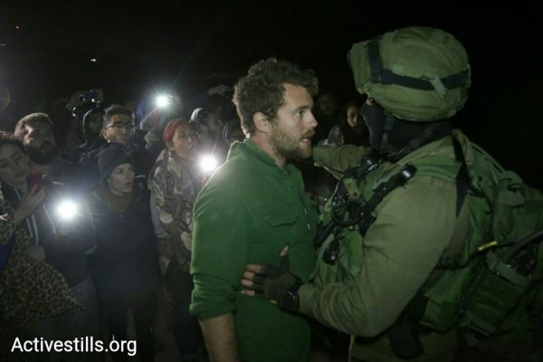 Israeli soldiers confront Jewish American activists in Sarura, a village that had been rebuilt of Palestinian, Israeli, and international activists, May 21, 2017. (Ahmad al-Bazz/Activestills.org)