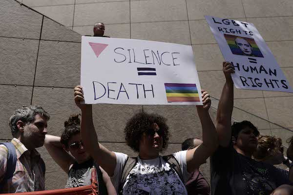 People protest outside the Russian Embassy in Tel Aviv calling to stop the persecution of the gay community in Chechnya, May 5, 2017. (Tomer Neuberg/Flash90)