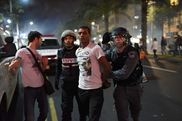 Police arrest a demonstrator during a protest by thousands of Israeli-Ethiopians in Tel Aviv against violence and racism, May 3, 2015. (Ben Kelmer/Flash90)
