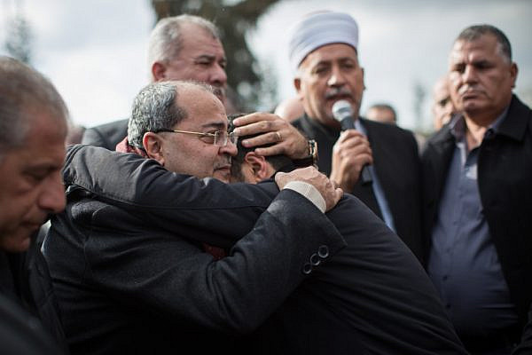 Knesset Member Ahmad Tibi hugs a family member of 19-year-old Lian Zaher Nasser during her funeral in her hometown of Tira, central Israel. Nasser was one of 39 people killed in a terror attack at an Istanbul nightclub shooting on New Years Eve, January 3, 2017. (Hadas Parush/Flash90)