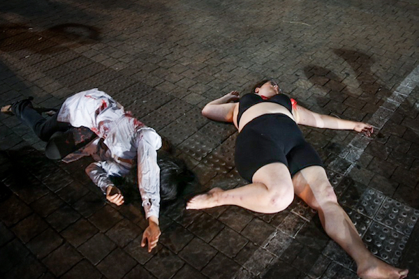 A theatric protest targeting violence against women following the murder of 41-year-old Maya Goren, Tel Aviv, June 11, 2017. (Flash90)