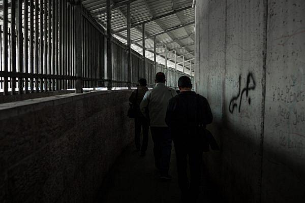 Palestinians walk through an Israeli checkpoint in the West Bank. (Sebi Berens/Flash90)