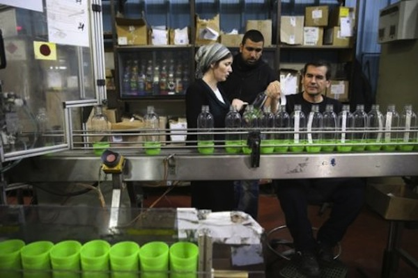 Illustrative photo of Sodastram workers in Israel. (Flash90)