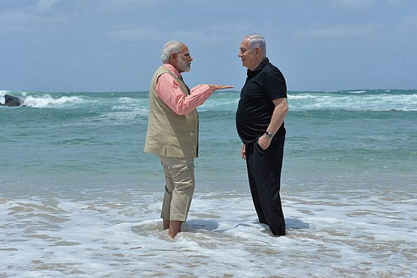 Israeli Prime Minister Benjamin Netanyahu and Indian Prime Minister Narendra Modi get their feet wet at Olga Beach, just 60 miles north of the Gaza Strip. (Kobi Gideon/GPO)
