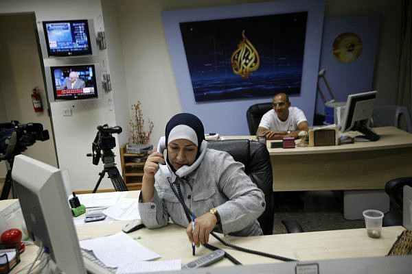 A Palestinian woman works at the Al Jazeera TV station in the West Bank city of Ramallah, June 14, 2009. (Miriam Alster/Flash90)