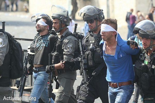 Police arrest a Palestinian demonstrator in the East Jerusalem neighborhood Wadi Joz, July 21, 2017. (Oren Ziv/Activestills.org)