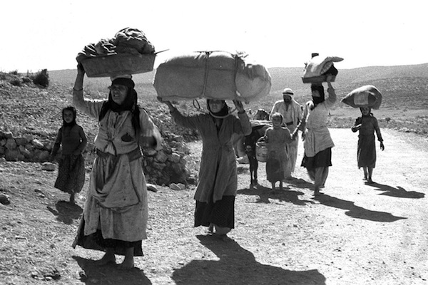 Palestinians flee from their village in the Galilee during the 1948 War, after it was conquered by Israeli forces. (GPO)