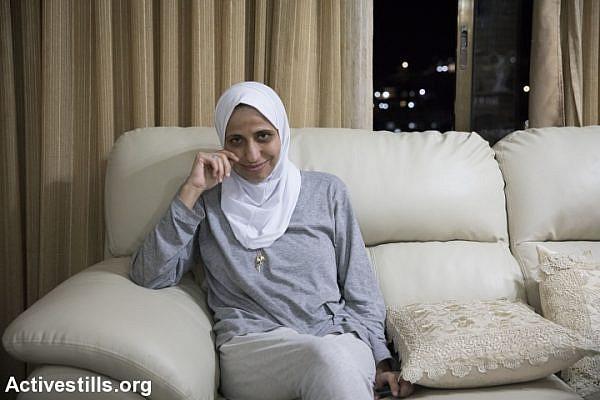 Daren Tatour is seen in her home in the town of Reineh, near Nazareth, August 23, 2017. (Oren Ziv/Activestills.org)