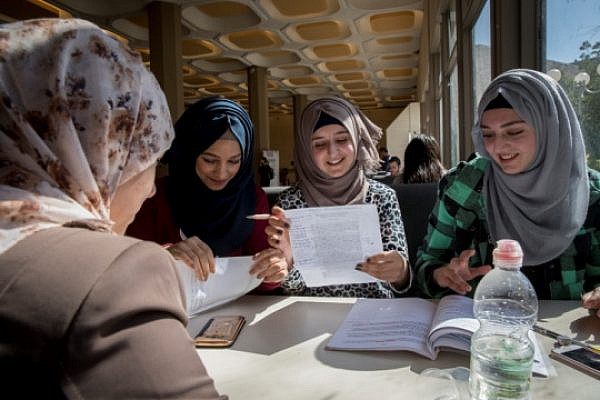 Palestinian women sit and study together at Hebrew University. (Nati Shohat/Flash90)