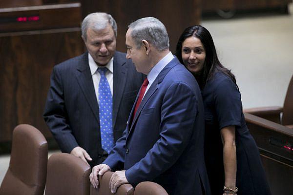 Israeli Culture Minister Miri Regev walks behind Prime Minister Benjamin Netanyahu in the Knesset during the opening of the winter session, Jerusalem, October 31, 2016. (Yonatan Sindel/Flash90)