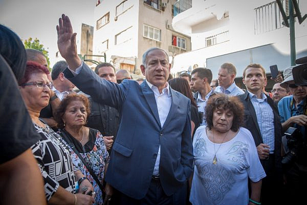 Prime Minister Benjamin Netanyahu meets with residents of South Tel Aviv, during a tour in the neighborhood, August 31, 2017. (Miriam Alster/Flash90)